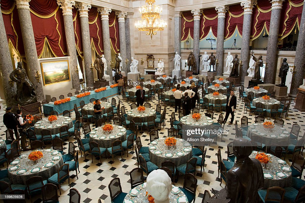 Caterers set up for the Inaugural Luncheon in Statuary Hall on Inauguration day at the U.S. Capitol building January 21, 2013 in Washington D.C. U.S. President Barack Obama will be ceremonially sworn in for his second term today.