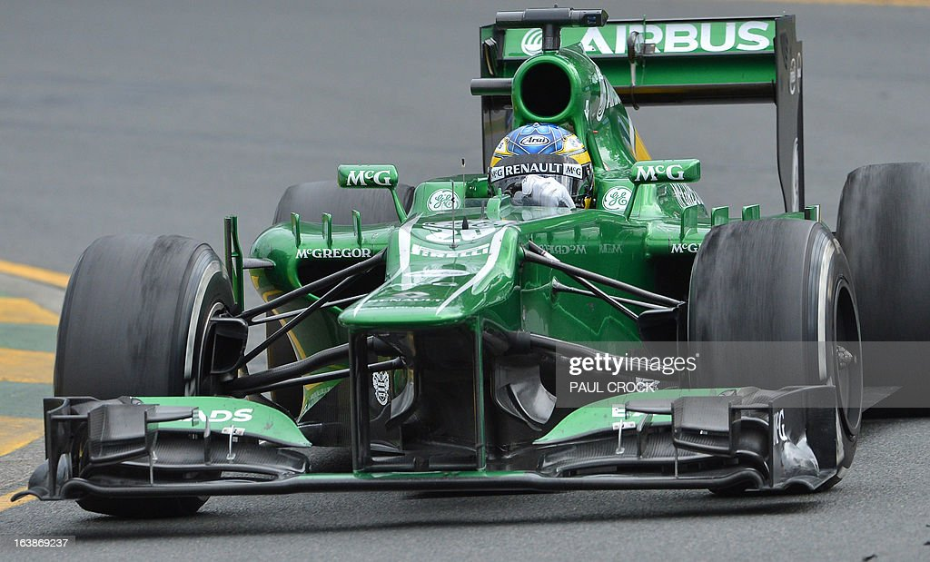 Caterham driver Charles Pic of France powers through a corner during the Formula One Australian Grand Prix in Melbourne on March 17, 2013. IMAGE RESTRICTED TO EDITORIAL USE - STRICTLY NO COMMERCIAL USE AFP PHOTO / Paul CROCK
