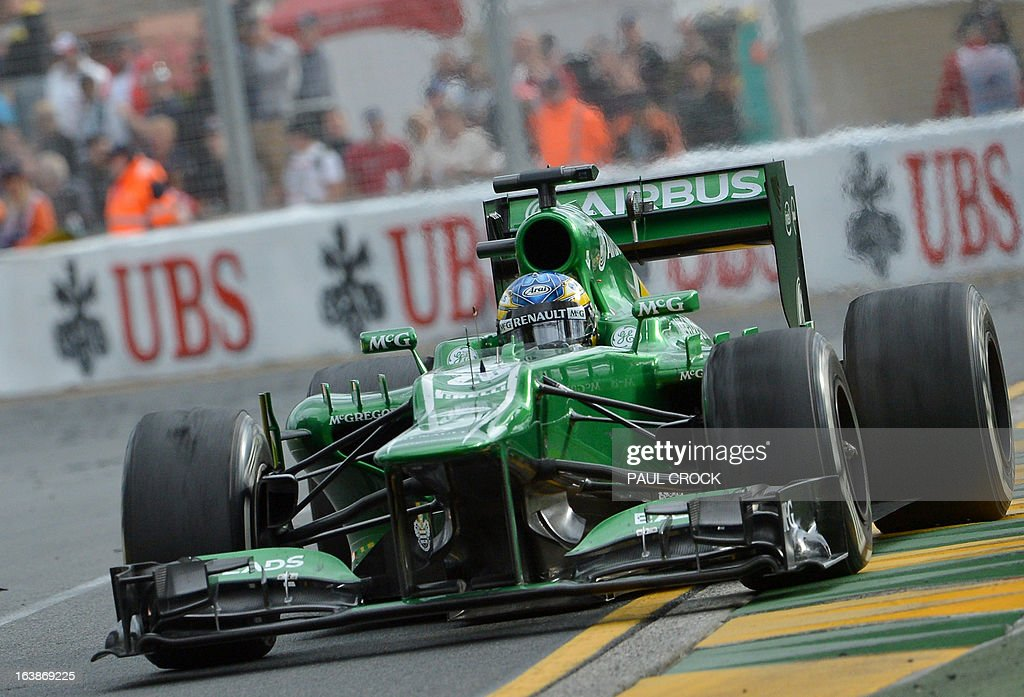 Caterham driver Charles Pic of France races out of a corner during the Formula One Australian Grand Prix in Melbourne on March 17, 2013. IMAGE RESTRICTED TO EDITORIAL USE - STRICTLY NO COMMERCIAL USE AFP PHOTO / Paul CROCK