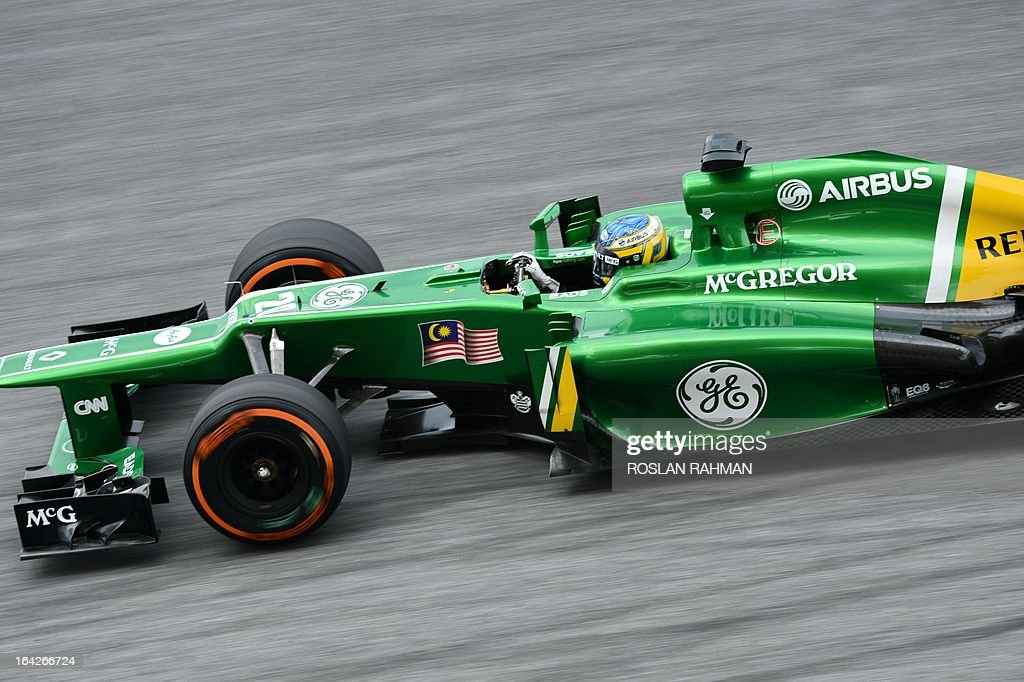 Caterham driver Charles Pic of France speeds up around a corner during the second practice session of the Formula One Malaysian Grand Prix at Sepang on March 22 , 2013. The Malaysian Grand Prix will take place on March 24.