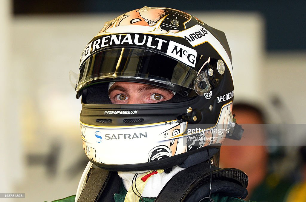 Caterham driver Giedo Van Der Garde of the Netherlands adjust his helmet during the third practice session for the Formula One Australian Grand Prix in Melbourne on March 16, 2013. AFP PHOTO/William WEST USE