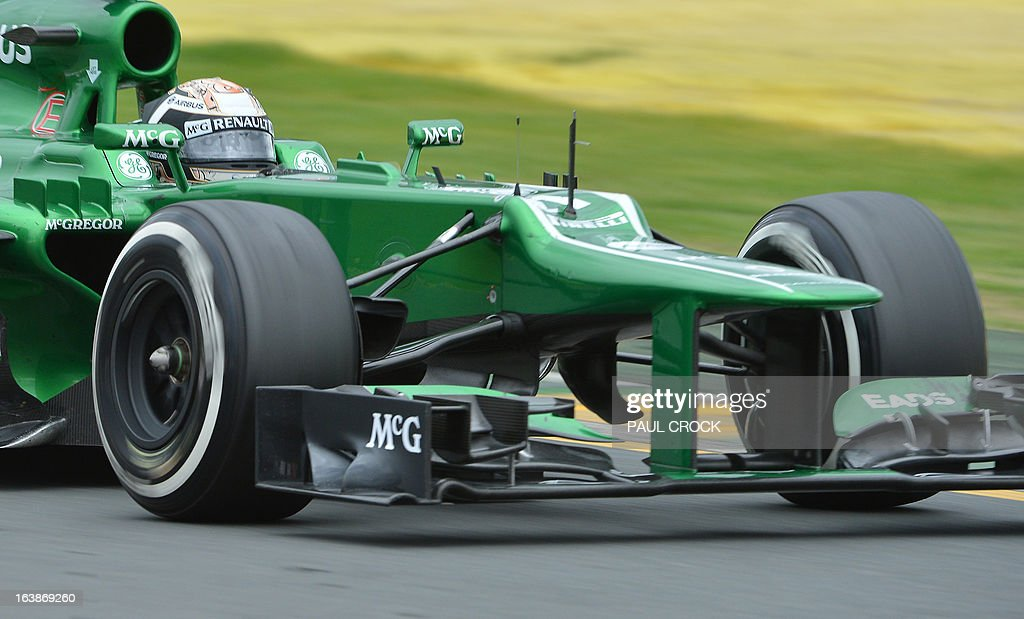 Caterham driver Giedo Van Der Garde of the Netherlands powers through a corner during the Formula One Australian Grand Prix in Melbourne on March 17, 2013. AFP PHOTO / Paul CROCK USE