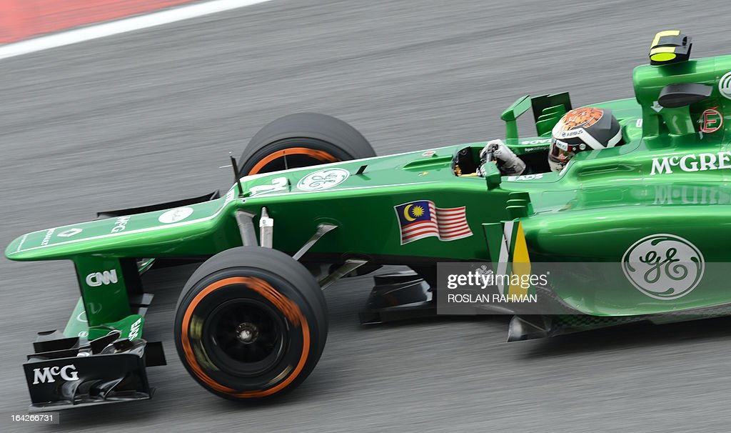 Caterham driver Giedo Van Der Garde of the Netherlands speeds up around a corner during the second practice session of the Formula One Malaysian Grand Prix at Sepang on March 22 , 2013. The Malaysian Grand Prix will take place on March 24. AFP PHOTO / ROSLAN RAHMAN