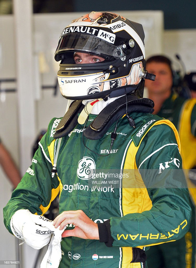 Caterham driver Giedo Van Der Garde of the Netherlands stands in his garage during the third practice session for the Formula One Australian Grand Prix in Melbourne on March 16, 2013. AFP PHOTO/William WEST IMAGE