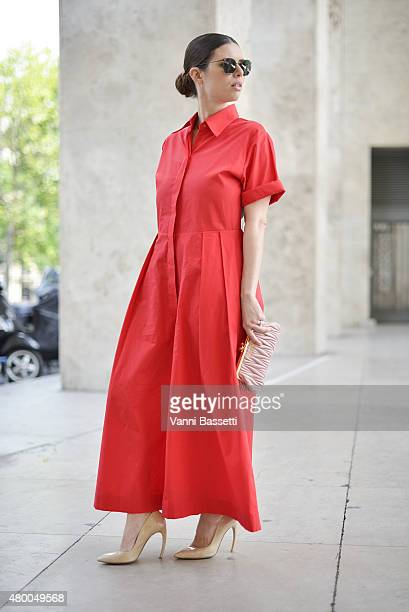 Caterina Minthe poses wearing a Reem Al Kanhal dress and a Miu Miu clutch before the Zuhair Murad show at the Palais de Tokyo on July 9 2015 in Paris...
