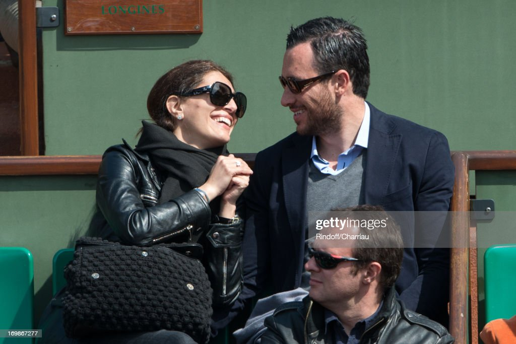 Caterina Murino and guest sighting at day nine of the French Open at Roland Garros on June 3 2013 in Paris France