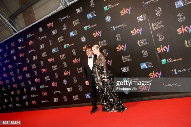 Caterina Shulha and Marco Berardi walk the red carpet of the 61 David Di Donatello on March 27 2017 in Rome Italy