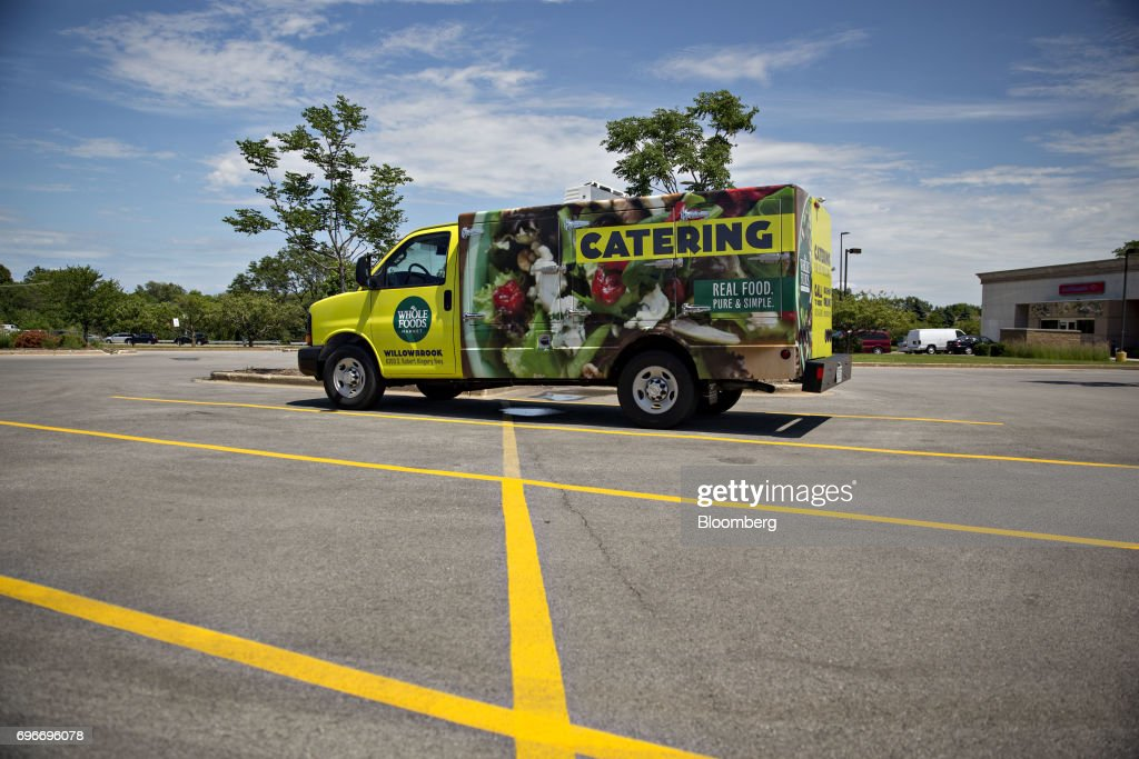 A catering vehicle sits outside a Whole Foods Market Inc. location in Willowbrook, Illinois, U.S., on Friday, June 16, 2017. Amazon.com Inc. will acquire Whole Foods Market Inc. for $13.7 billion, a bombshell of a deal that catapults the e-commerce giant into hundreds of physical stores and fulfills a long-held goal of selling more groceries. Photographer: Daniel Acker/Bloomberg via Getty Images