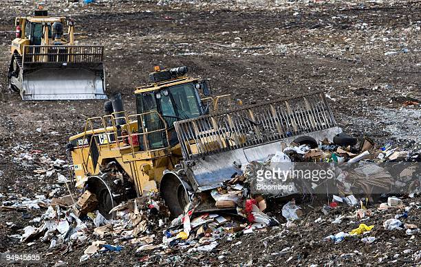 Caterpillar 836H landfill compactor drives over the active face of the Waste Management Central Landfill in Pompano Beach Florida US on Friday March...