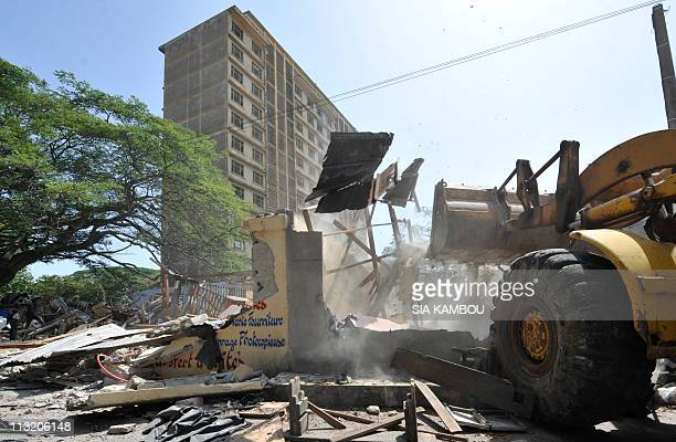 A caterpillar destroys the shops of the Sorbonne a site where young proGbagbo Patriots used to meet on April 19 2011 in the Plateau business district...