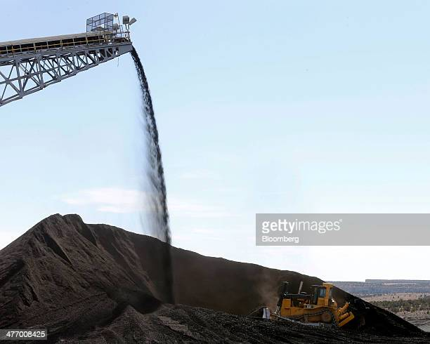 A Caterpillar earth mover moves piles of coal at the Wildcat Coal LoadOut Terminal owned by Intermountain Power Agency outside Price Utah US on...