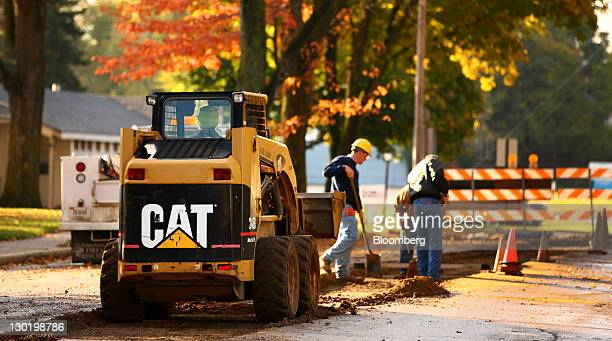 A Caterpillar Inc 248B skid steer loader aids contractors during road work in Topeka Indiana US on Monday Oct 24 2011 Caterpillar Inc the world's...