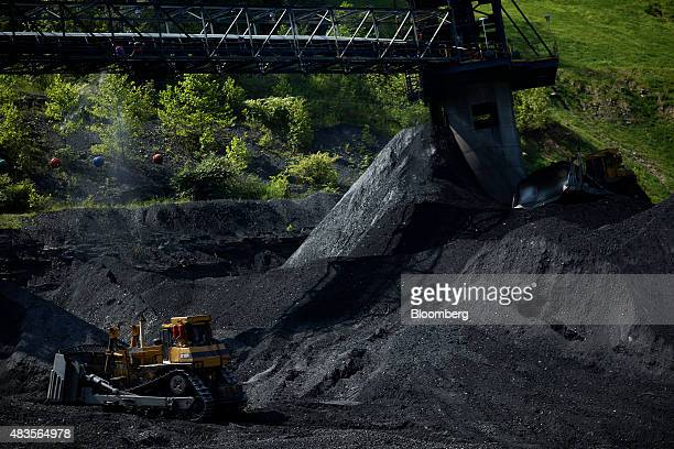 Caterpillar Inc D10R Crawler Tractor bulldozers move coal at an Alpha Natural Resources Inc coal preparation plant in Logan County near Yolyn West...