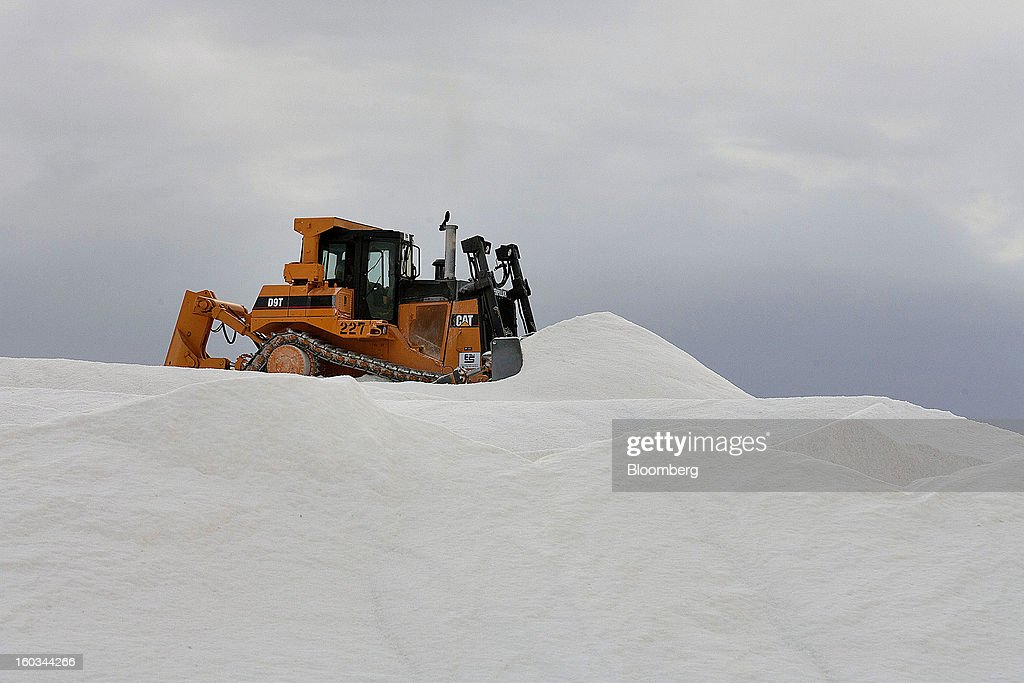 A Caterpillar Inc. D9T Crawler Tractor moves salt from the top of a stockpile at the Exportadora de Sal (ESSA) harvest fields in Guerrero Negro, Mexico, on Wednesday, Jan. 24. 2013. Exportadora de Sal (ESSA), a joint venture between Fidecomiso Mining Development Corporation and Mitsubishi, is one of the leading producers and suppliers of salt for the chlorine-alkali industry in the Pacific Rim. Photographer: Susana Gonzalez/Bloomberg via Getty Images
