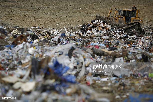 A Caterpillar Inc D9T Dozer spreads garbage at the Waste Management Inc Skyline Landfill in Ferris Texas US on Monday Oct 24 2016 Waste Management is...