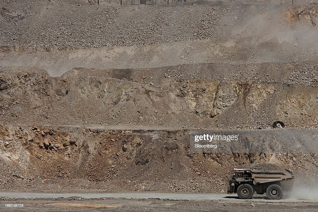 A Caterpillar Inc. dump truck transports copper material at Grupo Mexico SAB's La Caridad open pit copper mine in Sonora, Mexico, on Monday, May 6, 2013. Grupo Mexico SAB, Mexico's biggest mining company by market value, estimates it will produce 840,000 tons of copper in 2013. Photographer: Susana Gonzalez/Bloomberg via Getty Images