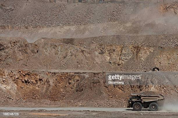 A Caterpillar Inc dump truck transports copper material at Grupo Mexico SAB's La Caridad open pit copper mine in Sonora Mexico on Monday May 6 2013...