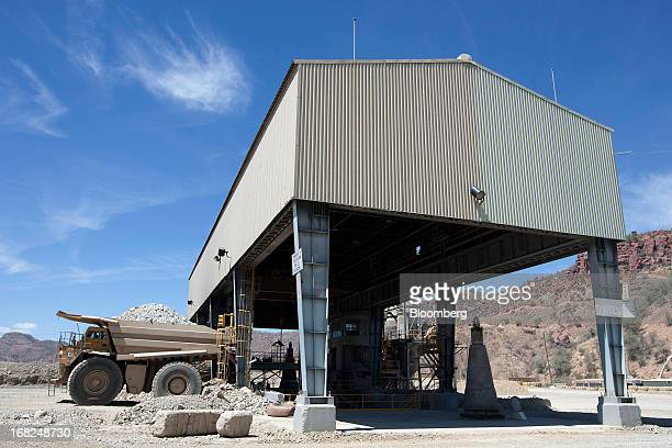 A Caterpillar Inc dump truck transports copper material to a crushing station at Grupo Mexico SAB's La Caridad open pit copper mine in Sonora Mexico...