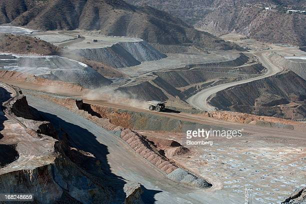 A Caterpillar Inc dump truck transports copper material to the crushing station at Grupo Mexico SAB's La Caridad open pit copper mine in Sonora...