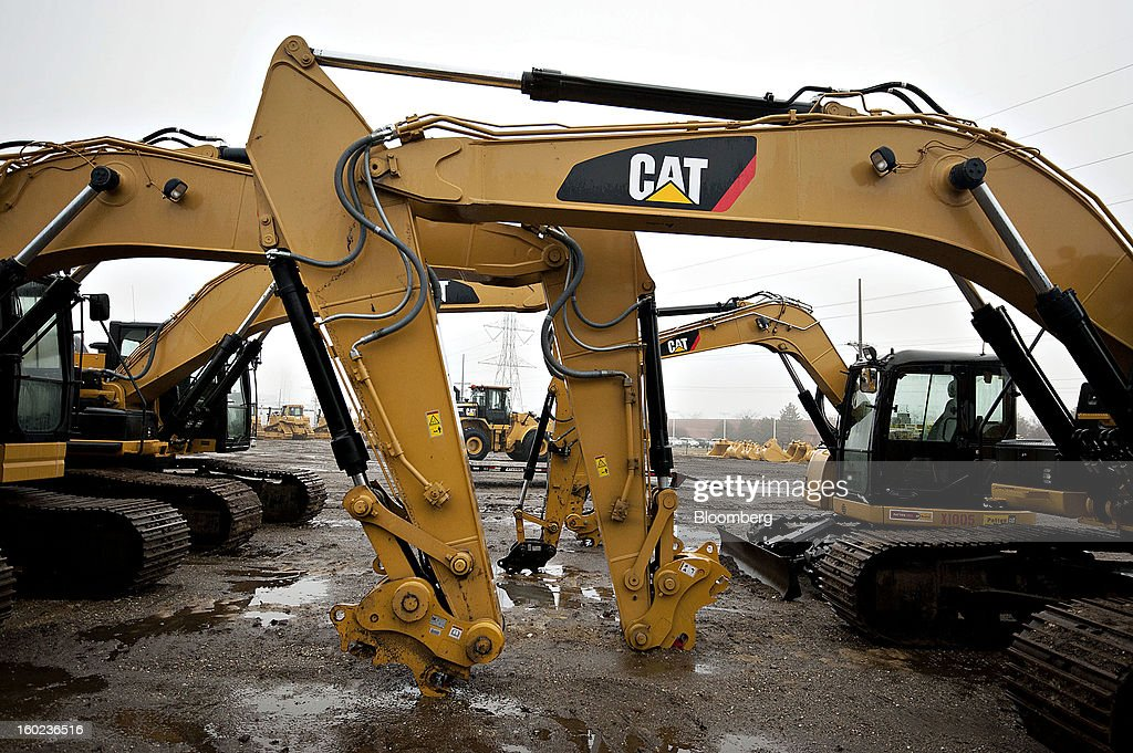 Caterpillar Inc. excavators sit on display at a Patten Industries Inc. dealership in Elmhurst, Illinois, U.S., on Monday, Jan. 28, 2013. Caterpillar Inc., the largest maker of construction and mining equipment, said gains in its sales and profit this year will come in the second half as the world economy improves. Photographer: Daniel Acker/Bloomberg via Getty Images