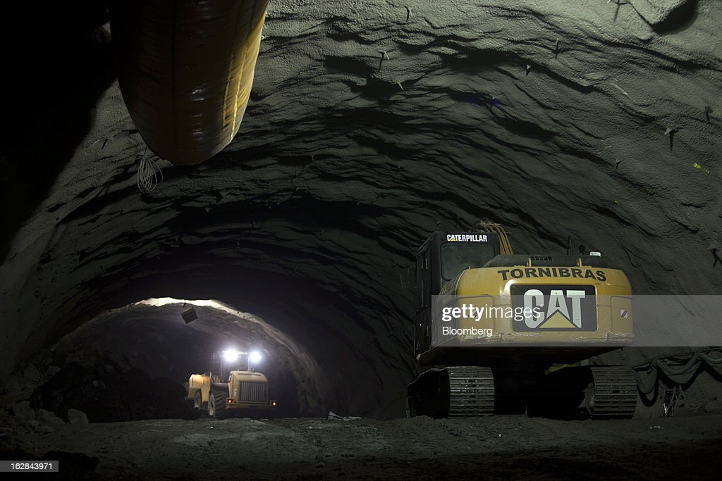 Caterpillar Inc. heavy equipment is used to dig the Binario tunnel in Rio de Janeiro, Brazil, on Thursday, Feb. 21, 2013. The tunnel is part of the $4 billion Porto Maravilha infrastructure project which aims to revitalize the the city's downtown and port area ahead of Brazil's hosting of the World Cup and Olympic Games. Photographer: Dado Galdieri/Bloomberg via Getty Images