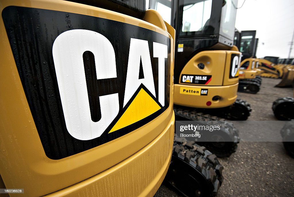 A Caterpillar Inc. logo appears on the back of a 303C CR mini hydraulic excavator at a Patten Industries Inc. dealership in Elmhurst, Illinois, U.S., on Monday, Jan. 28, 2013. Caterpillar Inc., the largest maker of construction and mining equipment, said gains in its sales and profit this year will come in the second half as the world economy improves. Photographer: Daniel Acker/Bloomberg via Getty Images