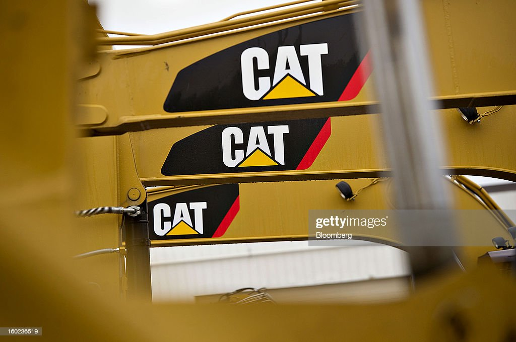 Caterpillar Inc. logos are seen on machinery sitting on display at a Patten Industries Inc. dealership in Elmhurst, Illinois, U.S., on Monday, Jan. 28, 2013. Caterpillar Inc., the largest maker of construction and mining equipment, said gains in its sales and profit this year will come in the second half as the world economy improves. Photographer: Daniel Acker/Bloomberg via Getty Images