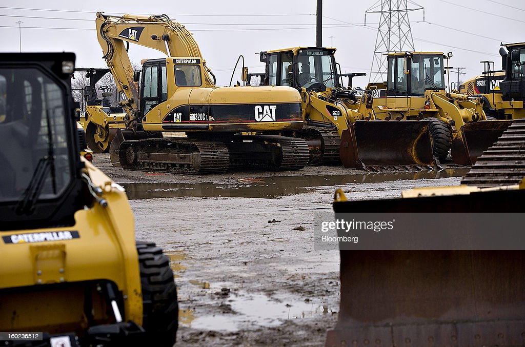 Caterpillar Inc. machinery sits on display at a Patten Industries Inc. dealership in Elmhurst, Illinois, U.S., on Monday, Jan. 28, 2013. Caterpillar Inc., the largest maker of construction and mining equipment, said gains in its sales and profit this year will come in the second half as the world economy improves. Photographer: Daniel Acker/Bloomberg via Getty Images