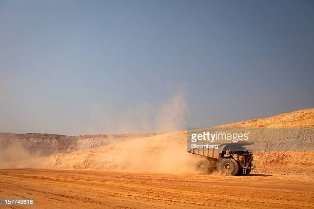 A Caterpillar Inc mining truck arrives to collect newlyexcavated ore from an open pit excavation at Katanga Mining Ltd's KOV copper and cobalt mine...
