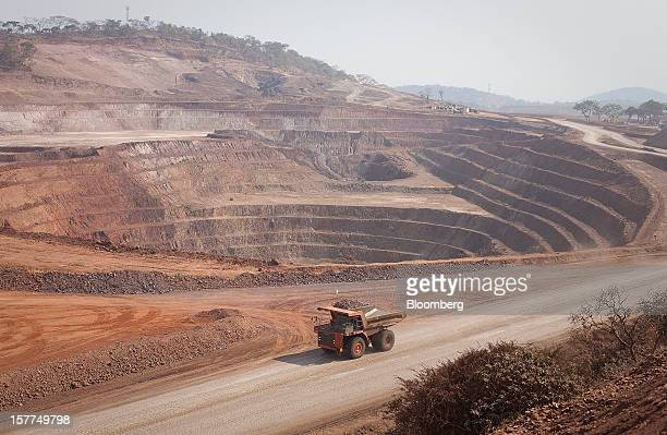 A Caterpillar Inc mining truck drives past an open pit excavation at the Mutanda copper and cobalt mine in Mutanda Katanga province Democratic...