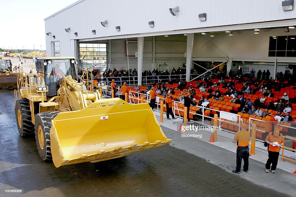 A Caterpillar Inc. wheel loader is offered during a Ritchie Bros. Auctioneers Inc. industrial equipment auction in Dunnigan, California, U.S., on Thursday, May 20, 2010. More than 1,400 lots were offered during the multi-million dollar unreserved public auction through Ritchie Bros., the world's biggest auctioneer of industrial equipment. Photographer: Ken James/Bloomberg via Getty Images