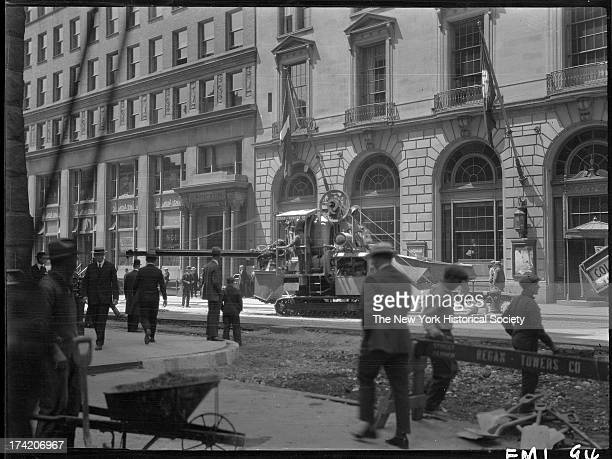 Caterpillar tractor and concrete mixer in front of the South Ferry Building Whitehall Street New York New York 1906