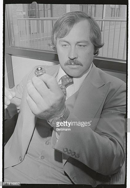 Catfish Hunter who pitches game of the World Series for the Yankees shows World Series ring he won with the Oakland A's and which he hopes to match...
