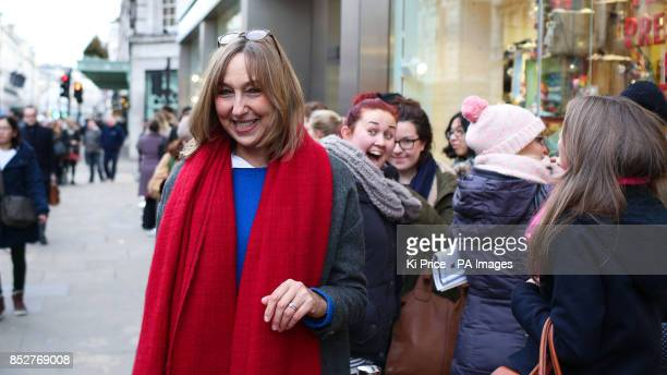Cath Kidston talks to members of the public in the queue outside the opening of the Cath Kidston flagship store on Piccadilly London