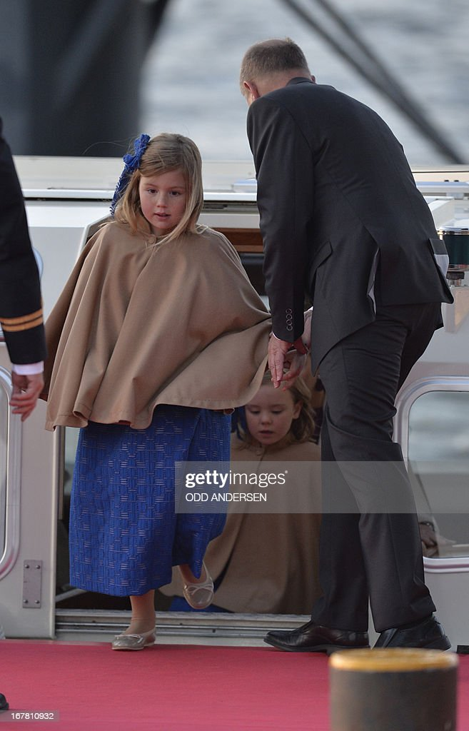 Catharina-Amalia, Netherlands' Princess of Orange steps out of a boat on April 30, 2013 after taking part in a water pageant on the river IJ in Amsterdam on the day of the new King's investiture