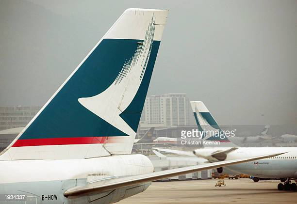 Cathay Pacific airplanes stand on the tarmac of Chek Lap Kok airport April 16 2003 in Hong Kong China Cathay Pacific Airways have cut their flights...