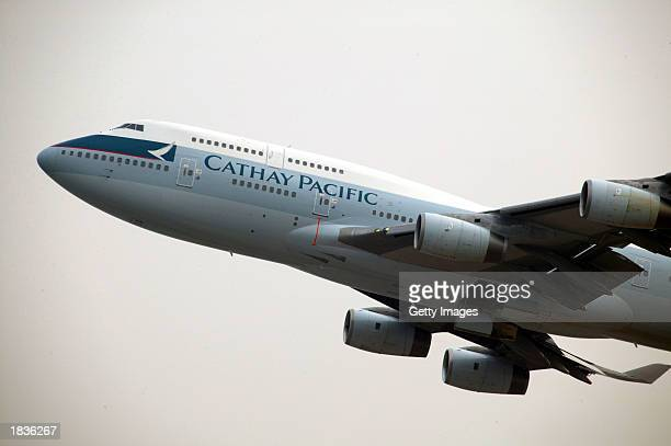 Cathay Pacific Airways 747 passenger plane takes off from Chek Lap Kok airport March 7 2003 in Hong Kong Cathay Pacific Airways Hong Kong's largest...