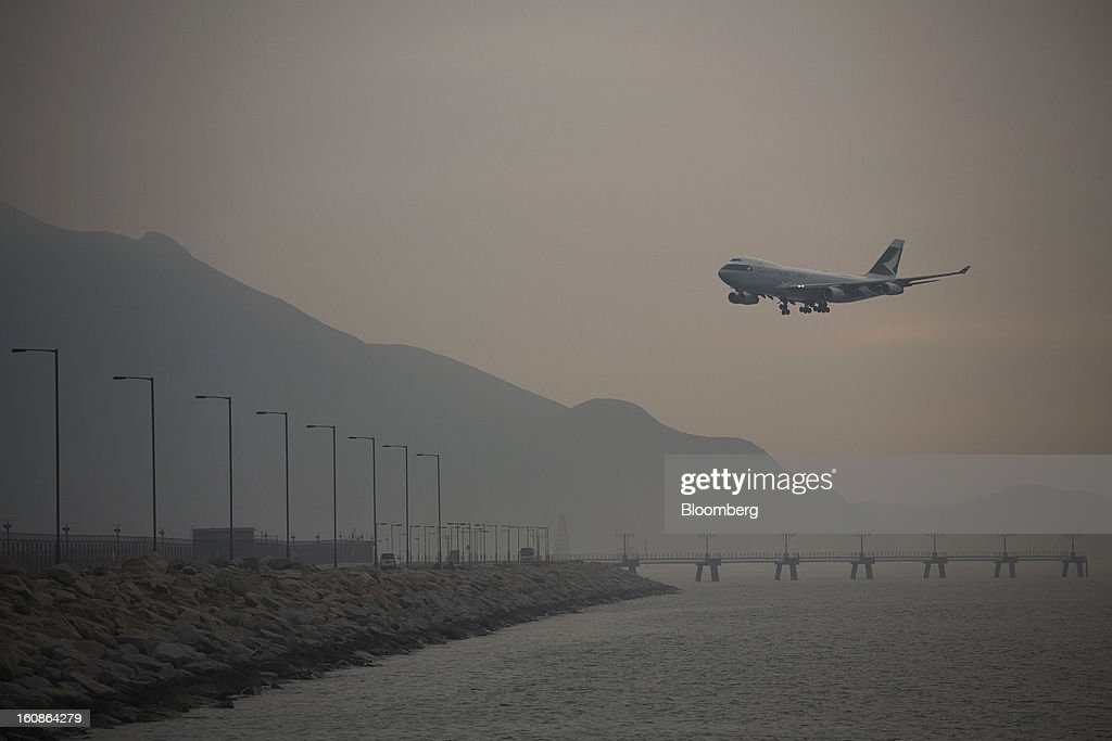 A Cathay Pacific Airways Ltd. cargo aircraft approaches to land at Hong Kong International Airport in Hong Kong, China, on Monday, Feb. 4, 2013. Cathay Pacific aims to replicate its business-class strategy in a cargo trade upgrade. Photographer: Jerome Favre/Bloomberg via Getty Images