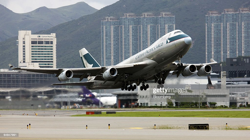 Cathay Pacific Cargo flight takes off from the Chek Lap Kok International Airport in Hong Kong China on Friday July 3 2009 The rise in jet fuel price...
