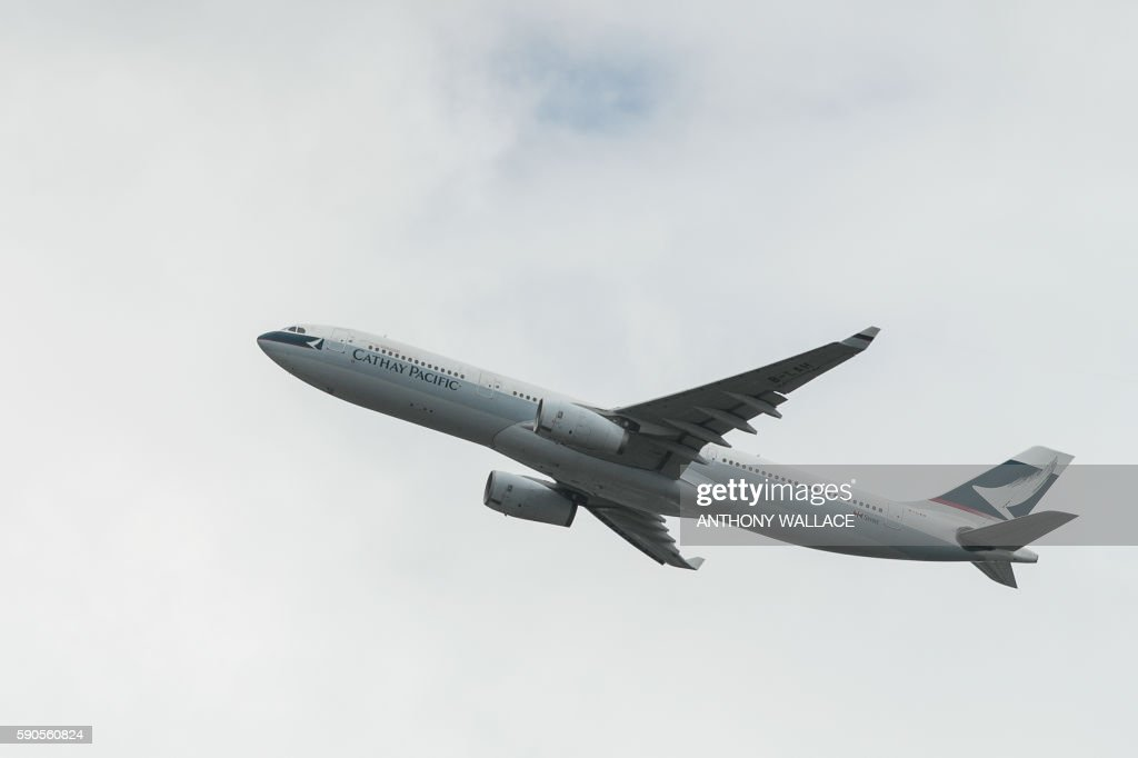 A Cathay Pacific passenger plane takes off from the international airport in Hong Kong on August 17 2016 Hong Kong flag carrier Cathay Pacific on...