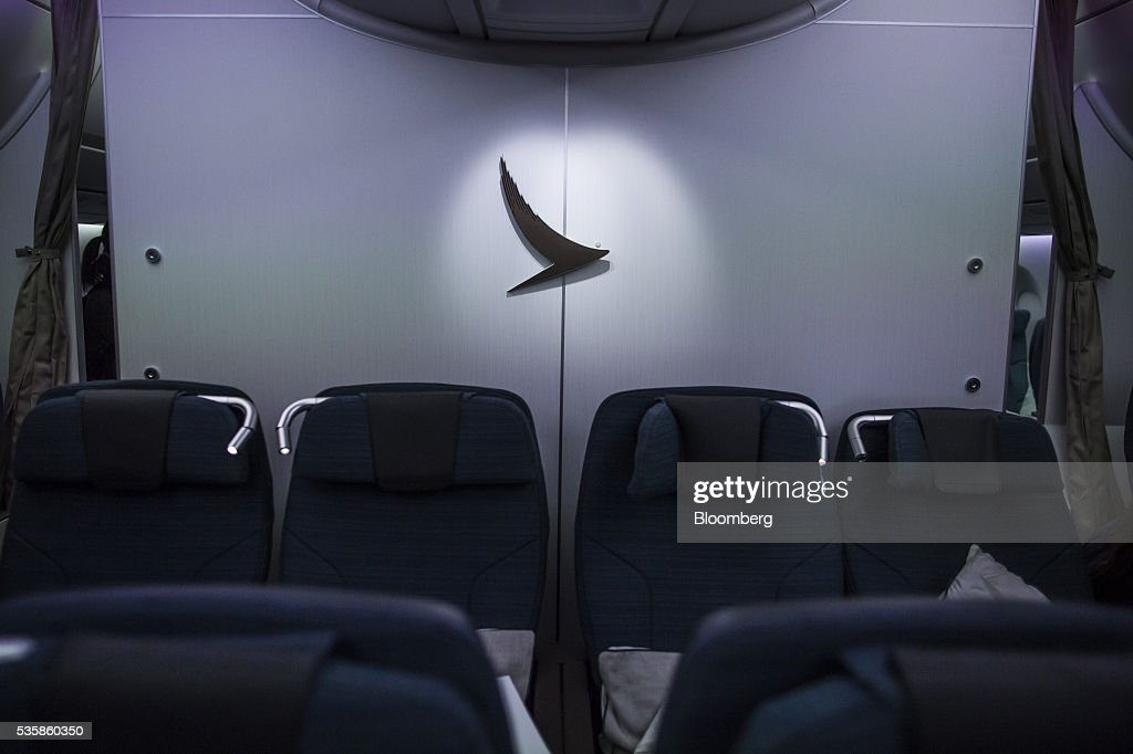 Cathay Pacific signage is displayed onboard an Airbus Group SE A350-900 aircraft operated by Cathay Pacific Ltd. during a media event in Hong Kong, China, on Monday, May 30, 2016. Airbus stuck to plans to increase plane deliveries this year as it pushes to overcome a series of problems affecting production of its newest aircraft. Photographer: Justin Chin/Bloomberg via Getty Images