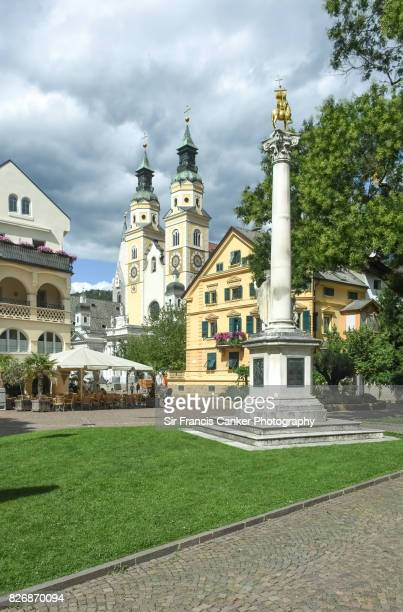 Cathedral and market square of Brixen (Duomo di Bressanone) with dramatic sky in South Tyrol, Italy, a UNESCO Heritage Site