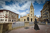 Cathedral and statue of woman in Oviedo