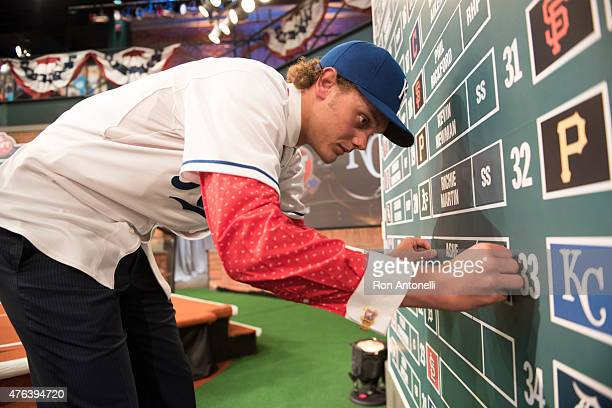 Cathedral High School pitcher Ashe Russell puts his name on the draft board after being selected 21st overall by the Kansas City Royals during the...