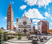 Ancient Cathedral of Cremona with famous Torrazzo bell tower and baptistery at beautiful market square Piazza Duomo in Cremona, Lombardy, Italy