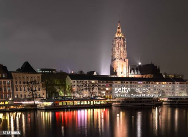 Cathedral Of Saint Bartholomew and reflections on river Main waterfront in Frankfurt, Germany