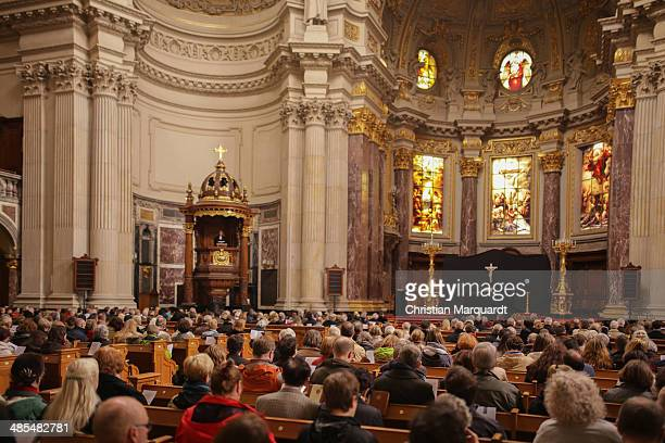Cathedral preacher Michael Koesling reads from the lectern during a service at the ecumenical Good Friday procession on April 18 2014 in Berlin...