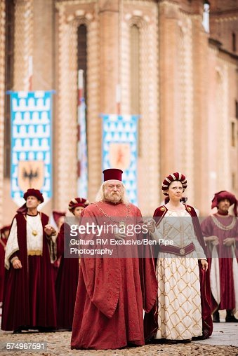 Cathedral procession of men and women in costume at Palio di Asti medieval festival, Asti, Piedmont, Italy