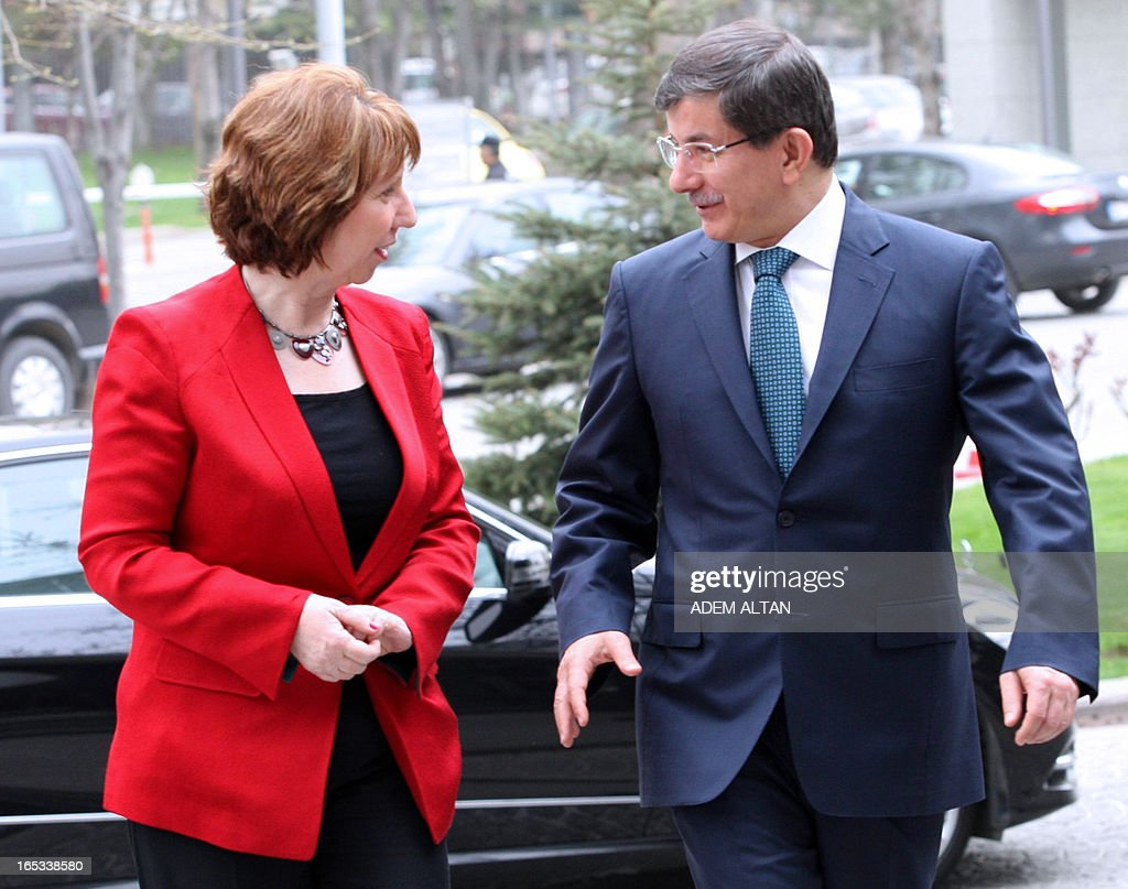 Catherine Ashton, the EU's foreign affairs chief, (L) is welcomed by Turkish Foreign Minister Ahmet Davutoglu prior to a meeting in Ankara, on April 3, 2013.