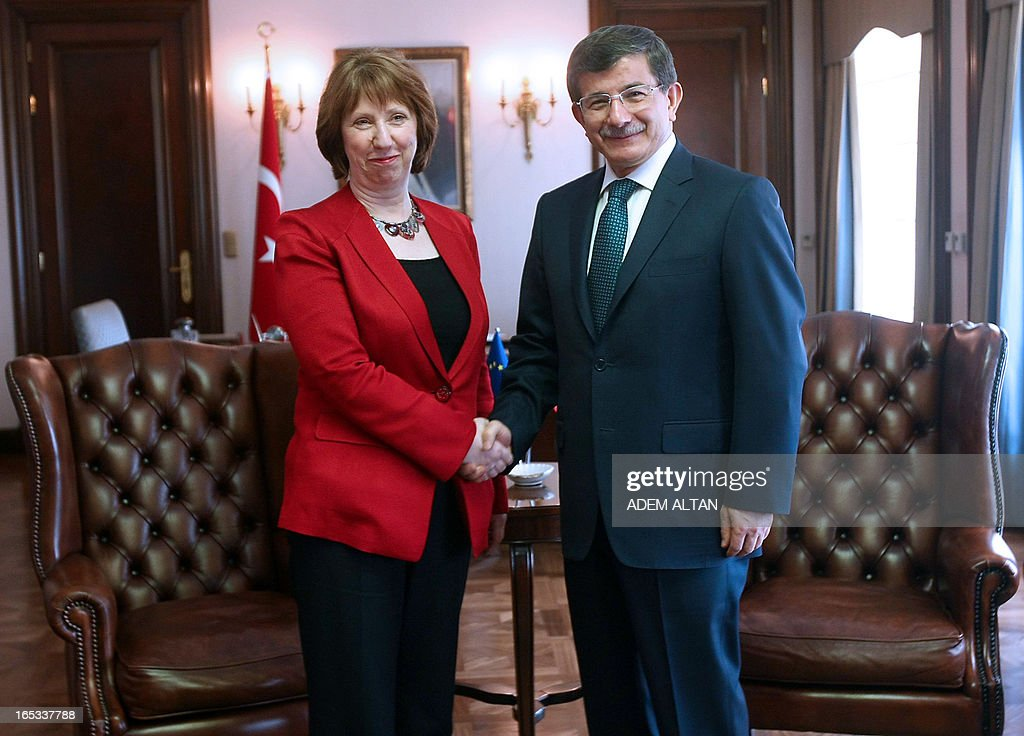 Catherine Ashton, the EU's foreign affairs chief, (L) shakes hands with Turkish Foreign Minister Ahmet Davutoglu prior to a meeting in Ankara, on April 3, 2013.